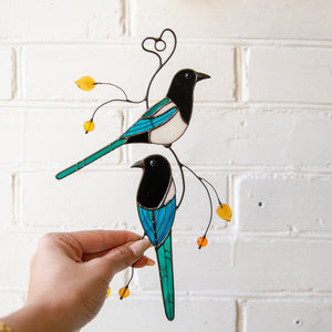 Two magpies window hanging of stained glass