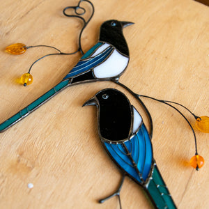 Zoomed stained glass magpies suncatcher