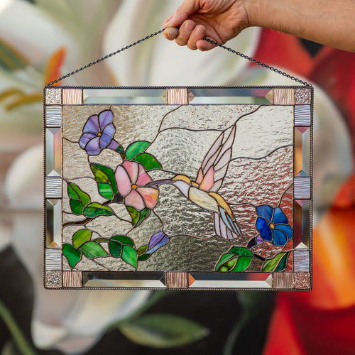 Stained glass panel depicting a flying hummingbird towards the flower