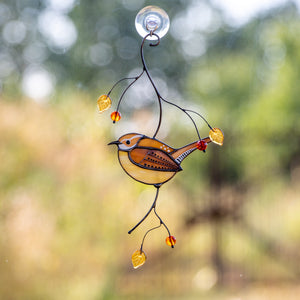 Stained glass suncatcher of Carolina wren sitting on the branch with leaves and berries
