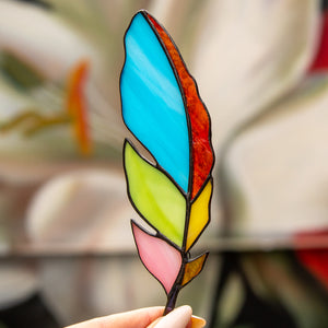 Stained glass feather suncatcher of different colours