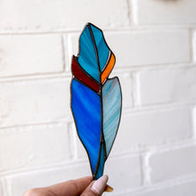 Load image into Gallery viewer, Stained glass feather of blue shades and red and orange parts suncatcher