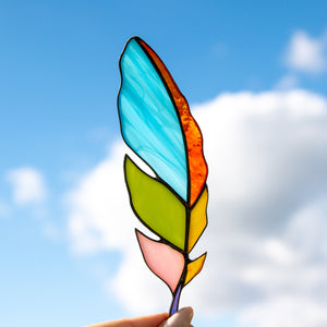 Bright colourful stained glass feather suncatcher