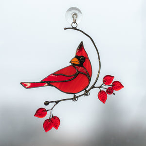 Stained glass suncatcher of a male cardinal on the branch