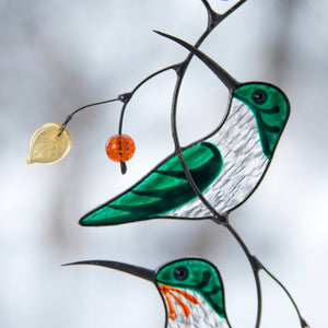 Zoomed stained glass green hummingbird window hanging