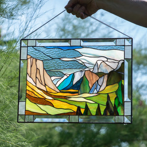 Stained glass window hanging depicting Yosemite national park