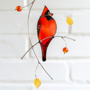 Stained glass suncatcher of a redbird on the branch