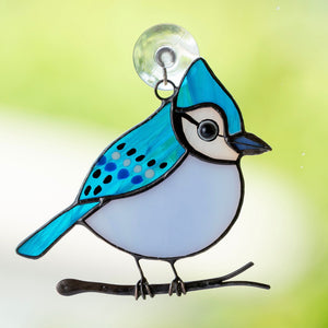 Stained glass blue jay bird sitting on the branch suncatcher