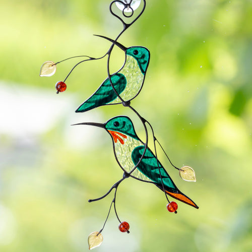 Stained glass green hummingbirds on the branch suncatcher