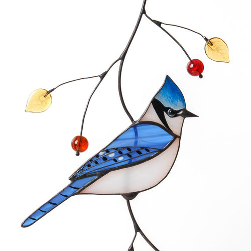 Stained glass blue jay with top knot sitting on the branch window hanging