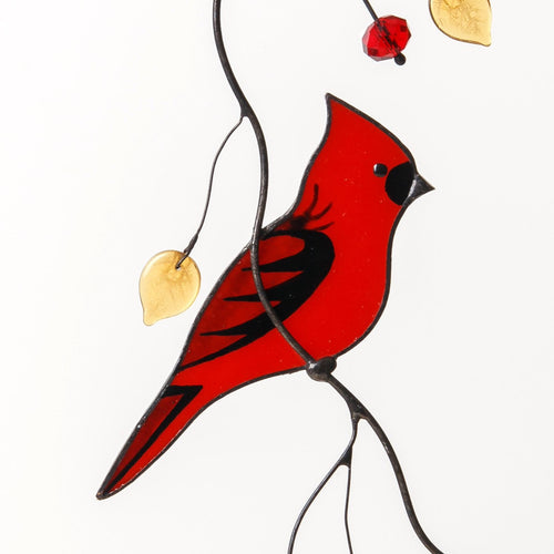 Zoomed stained glass cardinal bird on the branch window hanging