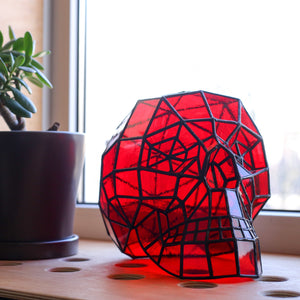 Red-coloured stained glass 3D human skull for Halloween celebrations