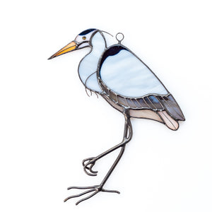 Stained glass blue heron standing on one leg suncatcher