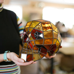 Ironman-coloured stained glass human skull for Halloween celebrations
