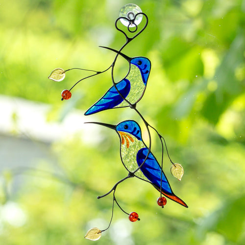 Two stained glass blue hummingbirds suncatcher