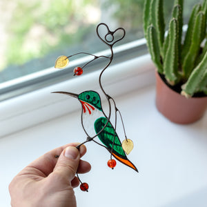 Green male hummingbird window hanging of stained glass