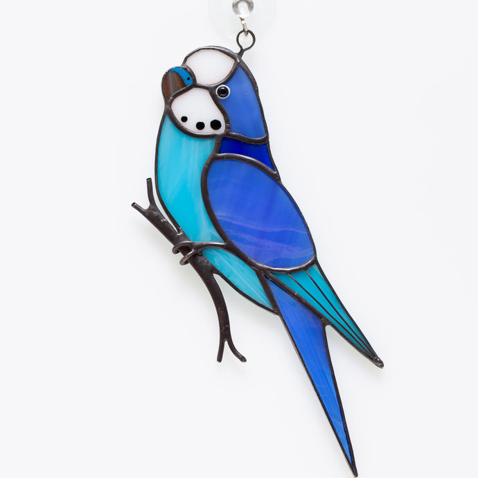 Stained glass blue budgie on the branch suncatcher