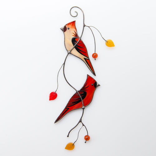 Stained glass cardinals sitting on the branch suncatcher