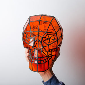Orange stained glass Halloween human skull decoration