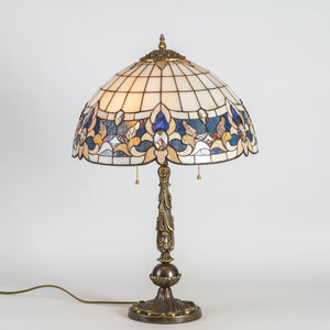Stained glass Tiffany lamp in beige colours with blue inserts