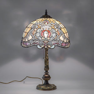 Lit stained glass Tiffany lamp in beige colour with purple markings