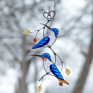 Stained glass blue hummingbirds on the branch window hanging