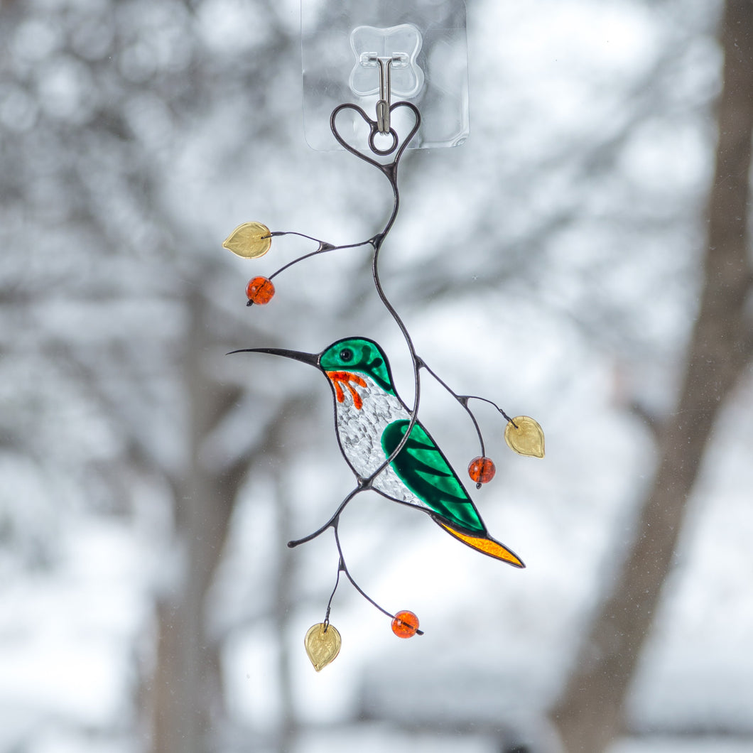 Stained glass male green hummingbird sitting on the branch suncatcher