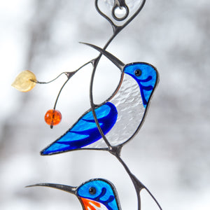 Zoomed stained glass blue hummingbirds suncatcher