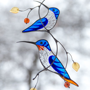 Blue stained glass hummingbirds on the branch window hanging