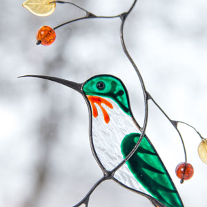 Zoomed stained glass male hummingbird suncatcher