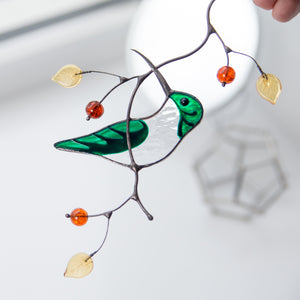 Stained glass green female hummingbird on the branch suncatcher