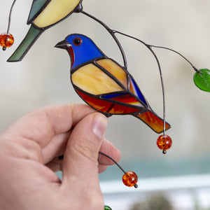Zoomed stained glass lower bunting bird window hanging