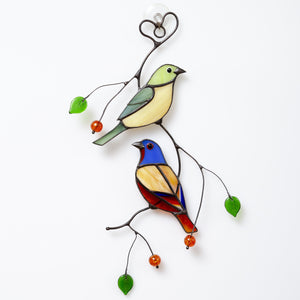 Stained glass bunting birds sitting on the branch with leaves and berries suncatcher