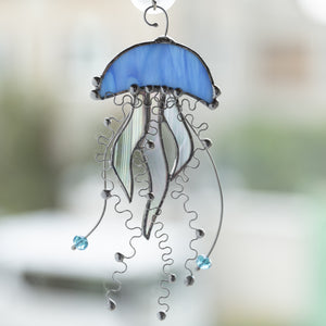 Blue stained glass jellyfish with iridescent tentacles window hanging for home decor