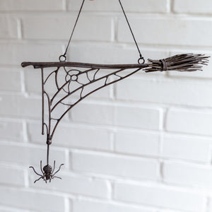 Halloween spider web with the broom and spider decoration for the wall