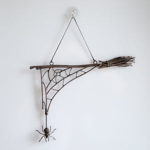 Spooky spider web with the spider and the broom for Halloween