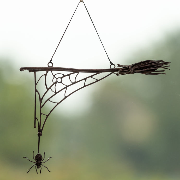 Wire Halloween spider web with the broom and spider in the lower part for window