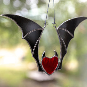 Stained glass vampire red heart with black wings for Halloween