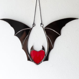 Red stained glass vampire heart with black wings Halloween creepy window hanging