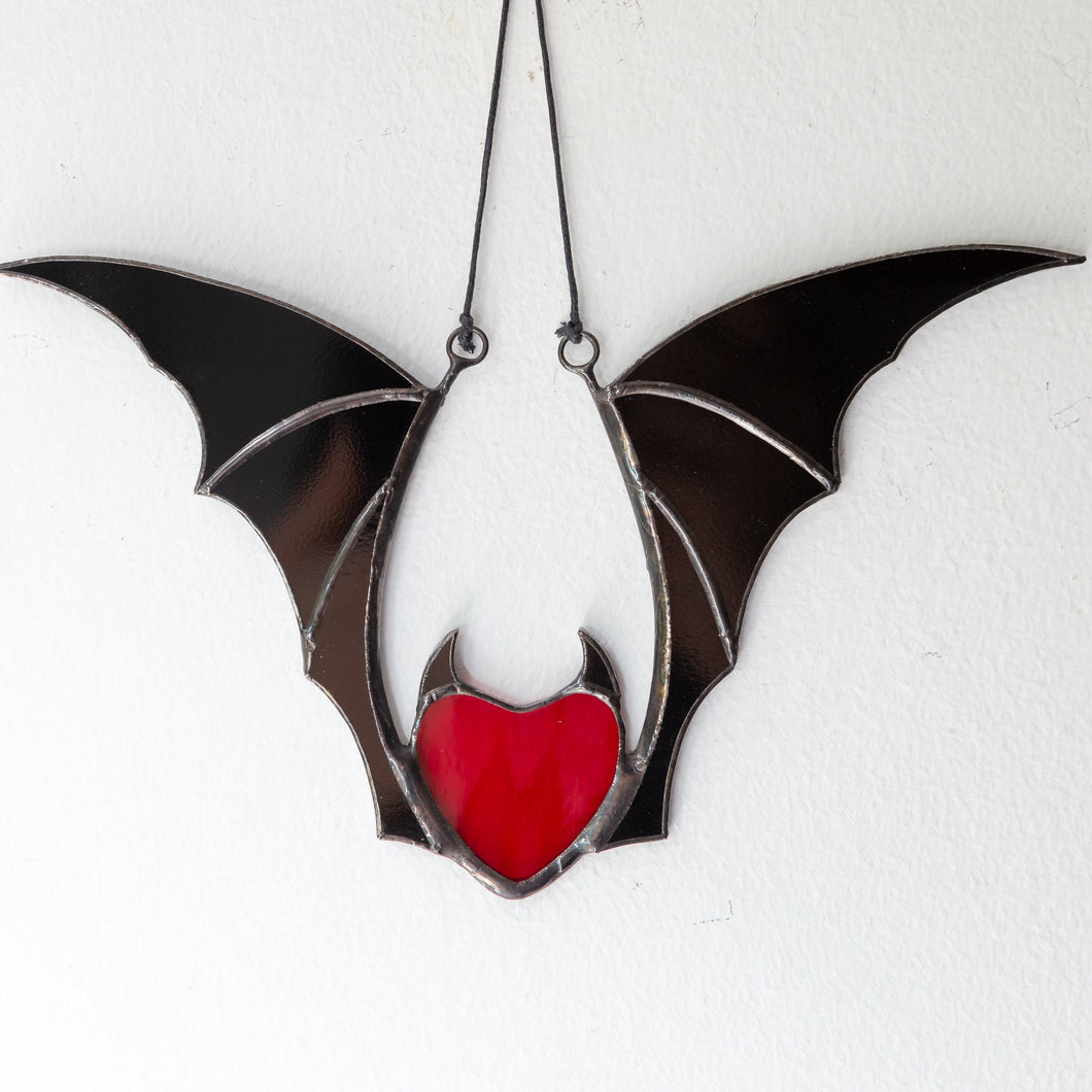Halloween stained glass vampire heart with black wings suncatcher