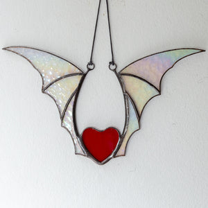 Red stained glass heart wit iridescent wings for Halloween celebration