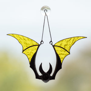 Yellow bat horror window hanging for Halloween
