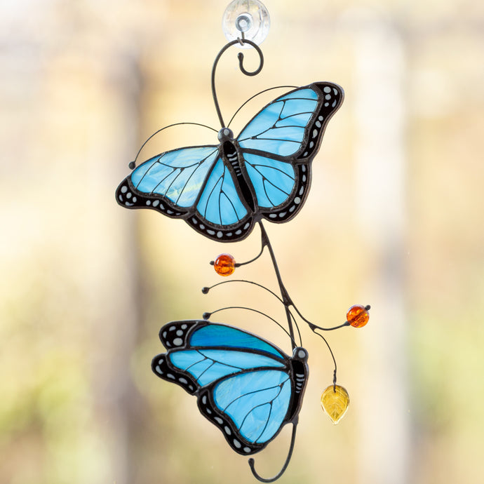 Stained glass morpho butterflies sitting on the branch suncatcher
