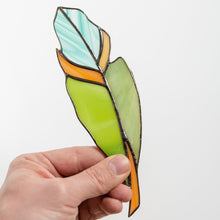 Load image into Gallery viewer, Stained glass green feather with shades of blue and orange suncatcher