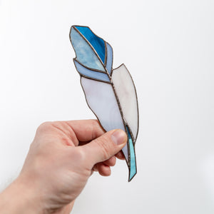 Stained glass feather suncatcher of blue colour and its shades