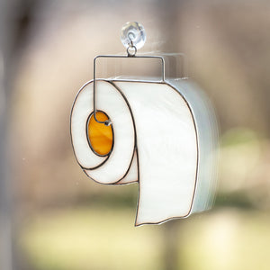 Window hanging of a stained glass toilet paper