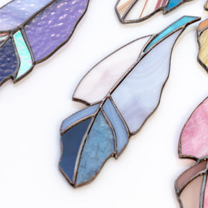 Stained glass feather of blue colour and its shades window hanging