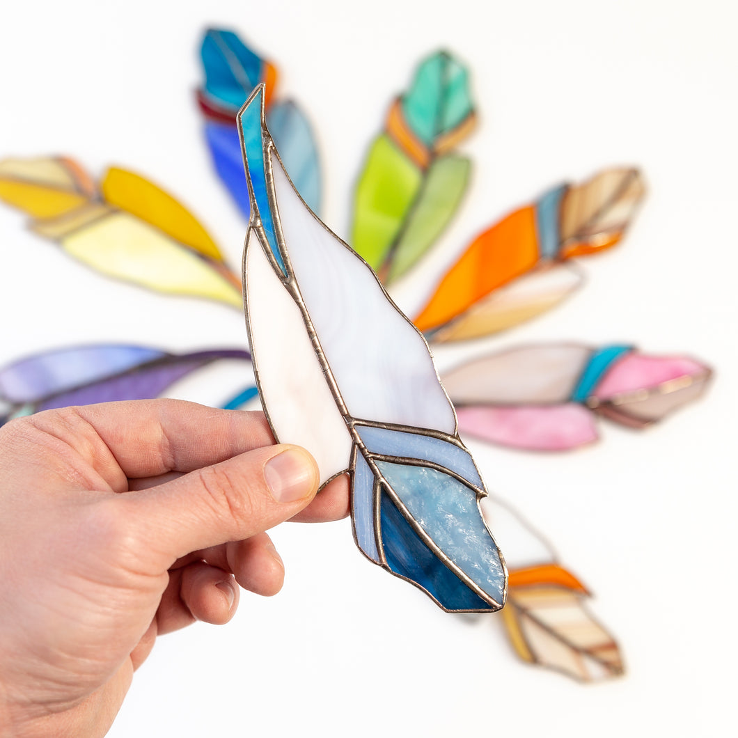 Suncatcher of a blue stained glass feather