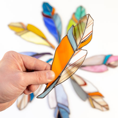 Stained glass orange feather with shades of blue suncatcher