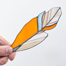 Load image into Gallery viewer, Orange feather suncatcher of stained glass